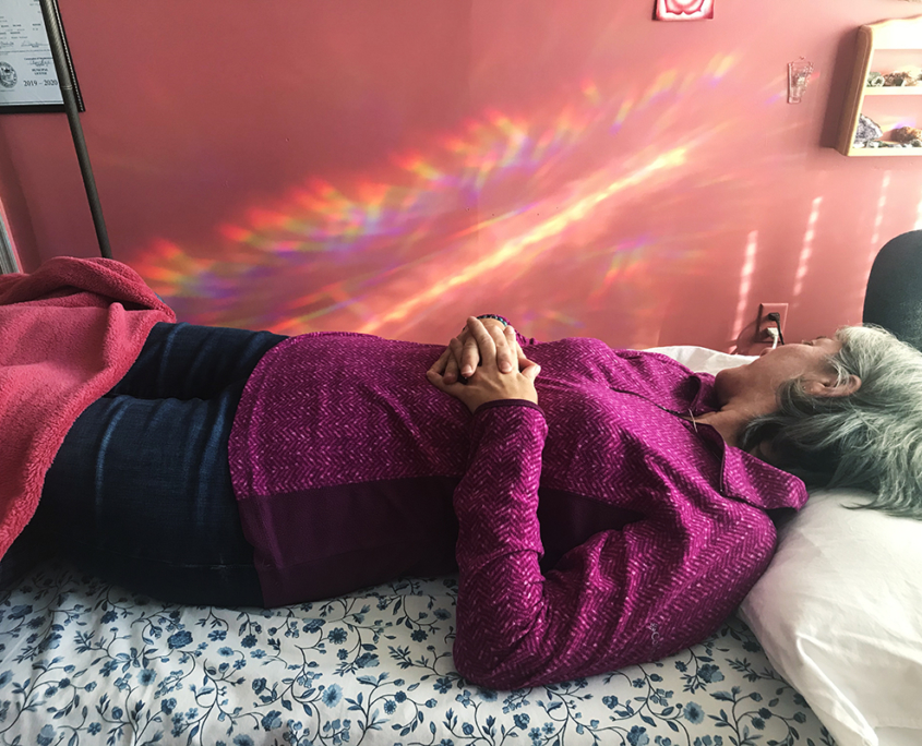 Not only the practitioner has the power to make a Reiki session go well. This client (who is wearing pink and laying on a table) was also able to use these techniques in order to strengthen the flow of Reiki in a session