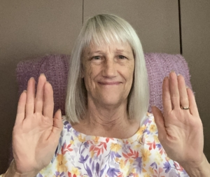 I offer virtual reiki sessions, I'm holding my palms up and smiling into the camera while sending energy