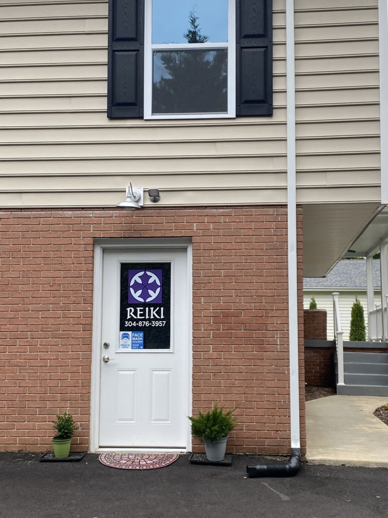 I got an intuitive nudge to look for a new Reiki office; here is the door and my purple and white sign